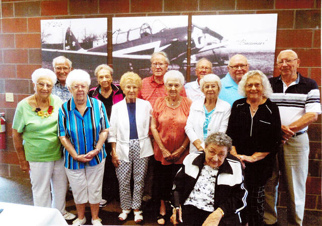 The Wauseon High School Class of 1949 met over the summer to both reminisce and catch up on their lives. Pictured are - front row - Mary Barnes Oyer, Joyce Lillich Hageman, MaryAnn Wolf Merillat, Merlin Graber O'Neill, Oneta Neuenschwander Wiechers, Jan Slagle Boyers, Carol Drewyor Ray (seated) - back row - James Roos, Ardith Masales Harris, Lowell Roth, Marvin Stoll, Richard Schwab, and Vernon Plassman.