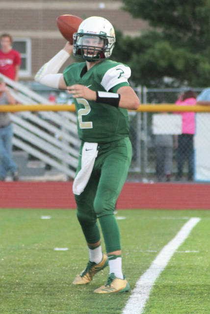 Evergreen quarterback Jack Etue passes the ball against Liberty Center on Friday.