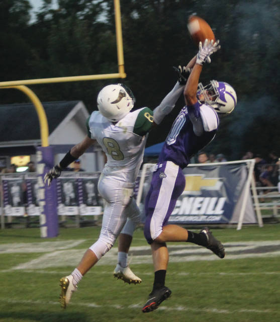 Anthony Howard hauls in a pass from Michael Lawniczak as Hunter Svoboda defends.