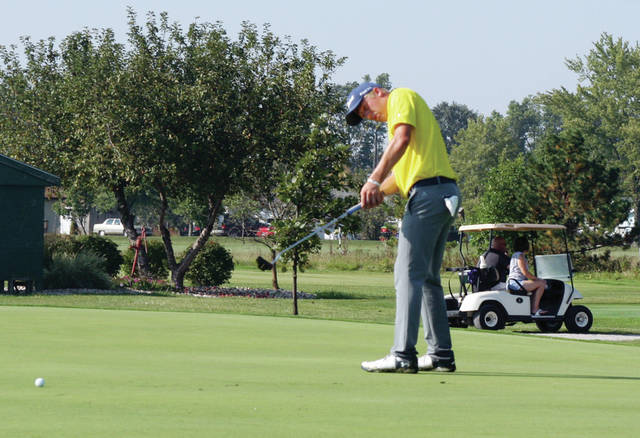 Archbold's Brandon Miller sends a putt toward the hole Friday at the NWOAL Golf Championships. Miller was one of four Blue Streak golfers to shoot in the 70s as they finished ahead of Bryan to claim their third straight league title.