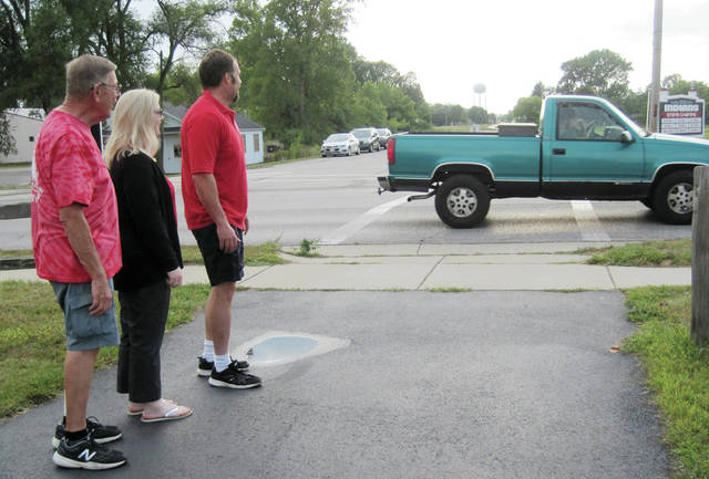 Lions, from left, Jerry Smith, Christy Shadbolt, and Tod Emerson observe Shoop Avenue traffic at the Wabash Cannonball Trail crossing.