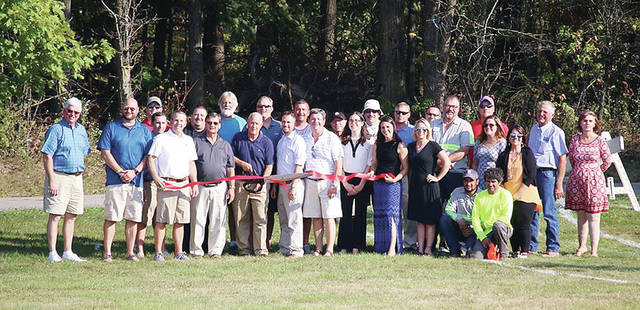 Members of the Wauseon Rotary Club and individuals who assisted in clearing woods for the new Indian Hill Trails adjacent to Homecoming Park participated Sept. 25 in a ribbon cutting ceremony. The passive walking routes winding through over one mile of trail were a Rotarian project, and will open this month.