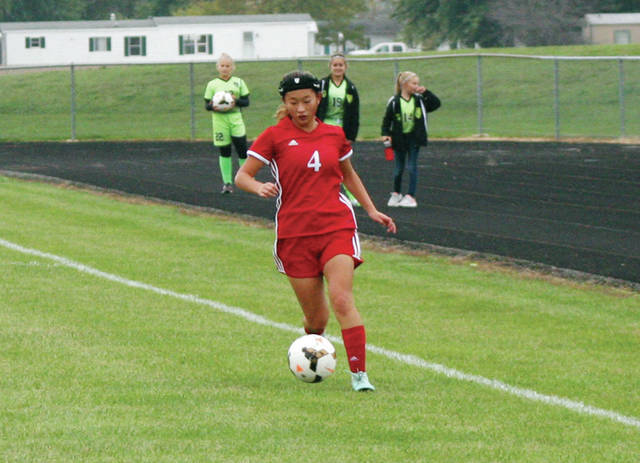 Wauseon's Briley Rupp advances a ball upfield Thursday in a league game at Delta. The Indians closed the regular season by beating the Panthers 2-0.