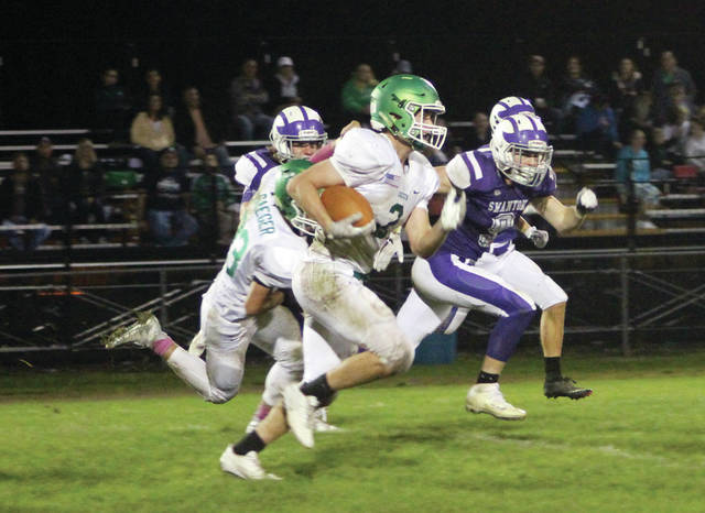 Delta running back Travis Dunning runs upfield as the Swanton defense gives chase Friday night. The Bulldogs would get the best of the Panthers 56-0.