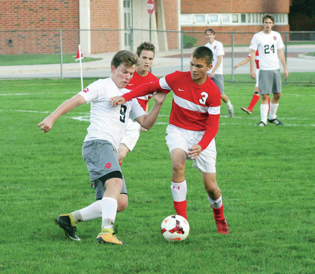Jacob Hageman of Wauseon (3) looks to take Aidan Hassett of Bowling Green, left, off the ball Monday in the boys soccer Division II sectional semifinal. The Indians were defeated by the Bobcats 6-0.