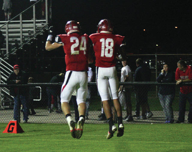 Wauseon's Owen Newlove, left, and Xavier Torres celebrate an Indian touchdown in the second quarter of Friday's 48-14 win over Patrick Henry.