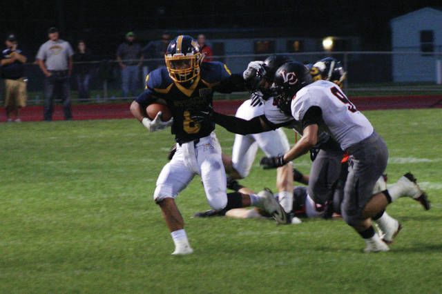 Archbold wide receiver Nic Rodriguez fights off Liberty Center defenders for a gain of seven yards Friday night in NWOAL action. The Blue Streaks bested the Tigers 21-12 to move to 6-1 on the season and 4-0 in the league.