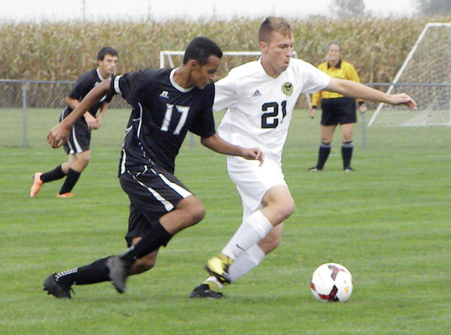 Anthony Russell of Delta, left, and Canidate Vickery of Pettisville go for a loose ball during Thursday's game. The Blackbirds bested the Panthers by a score of 9-2.