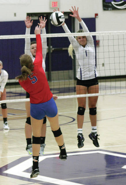 Riley Gardner and Julia Smith, right, of Swanton go up for a block of Faith Frania of Patrick Henry on Tuesday.