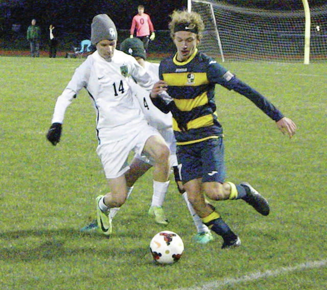 Archbold's Trey Theobold, right, goes for the ball in Saturday's district final against Ottawa Hills. The Blue Streaks came up short against the Green Bears, 2-1, ending their season.