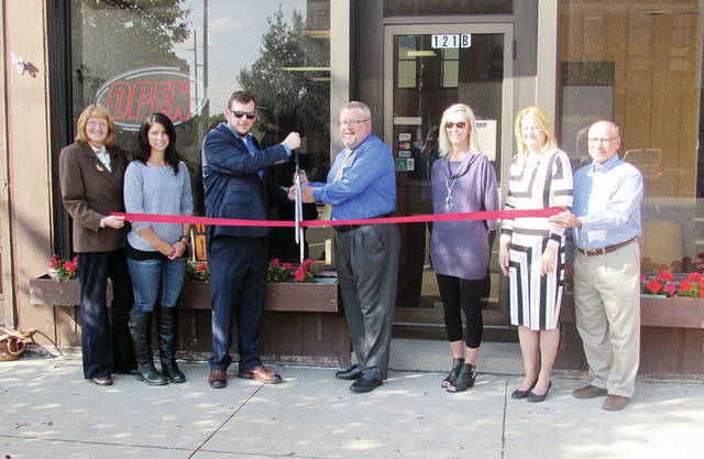 The owners of Custom Cleaners recently celebrated the opening of their third location, at 121 N. Fulton St. in Wauseon, with a ribbon-cutting ceremony alongside Chamber of Commerce members. The business offers dry cleaning and laundry services, linen rental, office and house cleaning, carpet cleaning, and alterations. Business hours are: Monday, 10 a.m.-5 p.m.; Tuesday, 8:30 a.m.-1 p.m.; closed Wednesday; Thursday, 8:30 a.m.-1 p.m.; Friday 10 a.m.-5 p.m.; Saturday, 9 a.m.-noon; closed Sunday. Pictured from left are Gloria Gunn, F&M Bank; Shannon Shulters, Fulton County Economic Development Corporation; Josh McCann and Mike McCann, owners; Gloria Kuntz, Chamber board; Sue Dieringer, F&M Bank; and Bill Drummer, Chamber executive director.