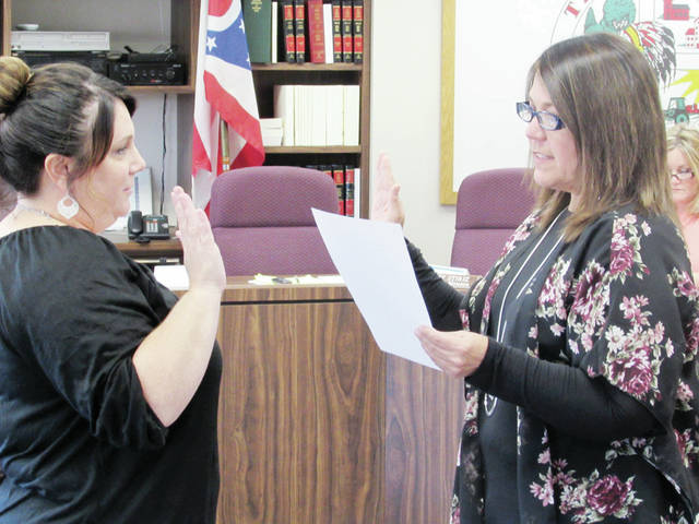 Andrea Gerken, left, Wauseon's new Clerk of Council, was sworn into office Monday by Mayor Kathy Huner.