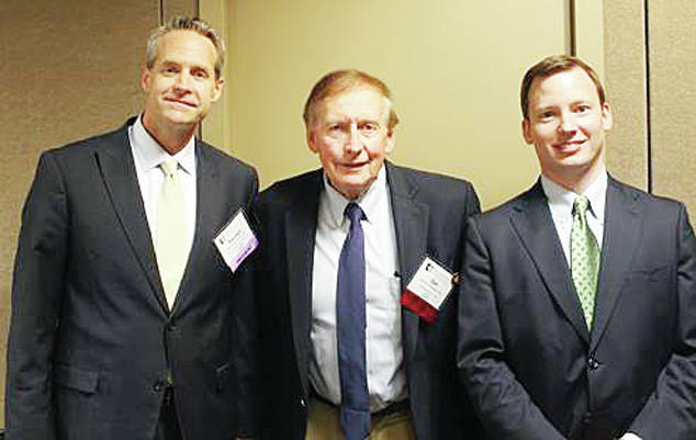 Daniel P. McQuade of Swanton, center, was recognized by the Ohio State Bar Association at the District 3 annual meeting Sept. 19 for 50 years of service to the profession. McQuade practices with The McQuades Co., L.P.A. McQuade is an AV Preeminent-rated attorney who focuses on criminal defense, estate planning, personal injury law, family law, and real estate. He has served as the president of both the Fulton County Bar Association and the Northwest Ohio Bar Association. He is also the founder of the Daniel P. McQuade Family Scholarship Endowment, which provides financial assistance to students at The Ohio State University Moritz College of Law. McQuade received his J.D. from The Ohio State University Moritz College of Law, and was awarded The Ohio State University Alumni Association Community Service Award in 2011 for his work in the community. He is pictured with OSBA President Randall Comer, left, and District 3 Representative to the OSBA Board of Governors R. Benjamin Franz.