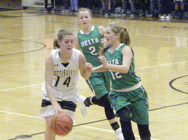 Pettisville's Morgan Leppelmeier takes the ball upcourt but is trapped by Abby Freeman (2) and Brooklyn Wymer (12) of Delta during a non-league game Tuesday. The Panthers defeated the Blackbirds 63-49.