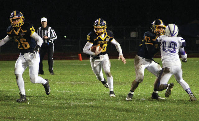 Gabe Petersen of Archbold, center, runs through a hole in a league game versus Swanton this season. Petersen was the NWOAL Offensive Player of the Year.