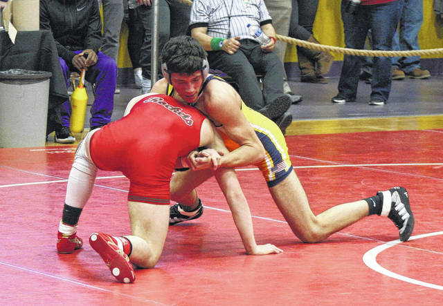 Archbold's Gavin Grime, top, wrestles in a match last season. Grime would place eighth at the state meet at 132 pounds.