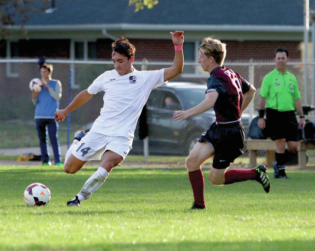 Josh Kidder of Archbold, left, boots a ball upfield in a tournament soccer game this season. He was the player of the year in the Northwest District for Division III, sharing the honors with Kevin Hileman of Ottawa Hills.