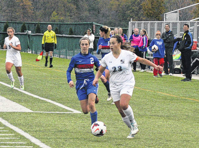 Kamryn Hostetler of Archbold, right, advances the ball upfield Saturday against Liberty-Benton in the Division III girls soccer regional final. The Blue Streaks fell to the Eagles 1-0.