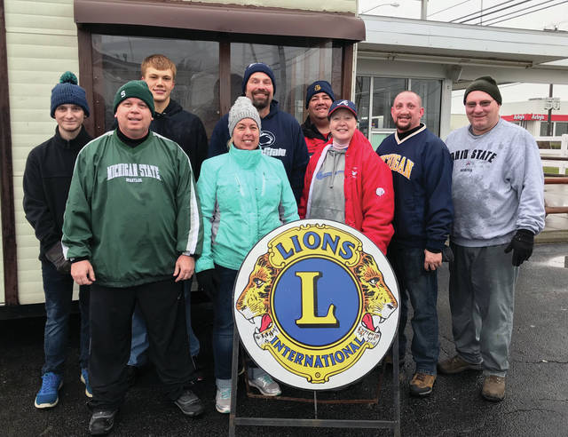 The Wauseon Lions gathered at Tiny's Dairy Barn early Saturday morning to unload the Christmas trees for the annual sale. Tree sales start Friday from noon-8 and will be open every day until all the trees are sold. Hours are Monday through Friday from 4-7:30 p.m., Saturday 9 a.m.- 8 p.m., and Sunday noon-6. Tree unloaders pictured are: Back row, from left,: Jordan Ward (NHS student volunteer), Brandon Moore (NHS student volunteer), Lion Tod Emerson, Lion Scott Brubaker. Front Row: Lion Mark Shadbolt, Lion Charlotte Emerson, Lion Christy Shadbolt, Lion Nick Schmunk and Lion Jeff Hench. Not pictured is photographer Rebecca Dent, Wauseon Lions Club President.