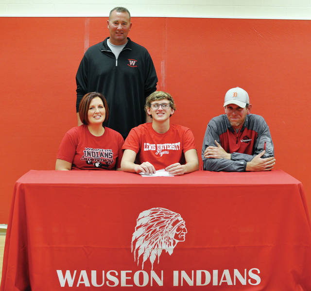 Nick Dilworth of Wauseon recently signed his National Letter of Intent to continue his education and swimming career at Lewis University in Romeoville, Ill. Pictured, front row, from left: Heather Dilworth (mother), Nick Dilworth, Jake Dilworth (father). Back row: Wauseon head swimming coach Tony Schuette.