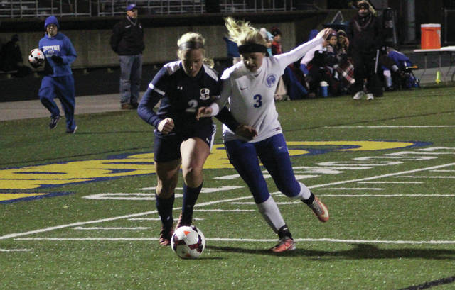 Emie Peterson of Archbold, left, battles for possession with Maddie Pappas of Chippewa Tuesday in the Division III girls soccer regional semifinal. Peterson recorded a hat trick to lift the Blue Streaks to a 4-1 win.