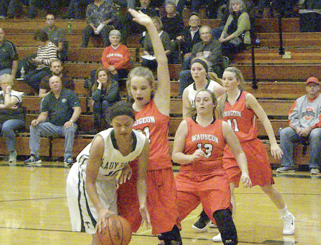 Wauseon's Chelsie Raabe and Rylee Campbell (13) defend Aaliyah Hurtt of Tinora during Saturday's contest. The Indians fell to the Rams on the road, 49-35.