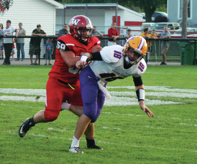 Wauseon's Cam Sauber, left, puts pressure on Bryan quarterback Zac Nobis in a game this season. Sauber was chosen honorable mention All-Ohio in Division IV.