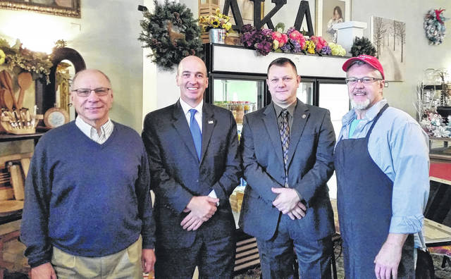 Members of the Secret Service were in Wauseon on Tuesday morning to give a presentation on credit card fraud, skimming devices, computer fraud and hacking. The event, sponsored by the Wauseon Chamber of Commerce, was held at AKA Designs on Fulton Street. Pictured at the event, from left, are Chamber of Commerce director Bill Drummer, special agent Steve Snyder, sergeant Josh Seney, and Marc Matheny, owner of AKA Designs.
