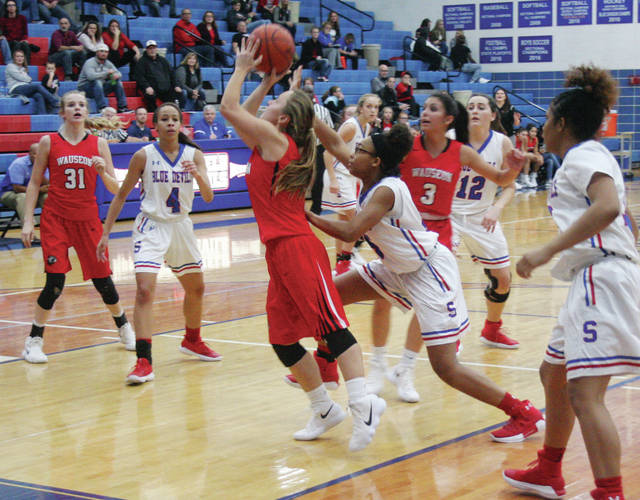 After grabbing a rebound, Ally Tefft of Wauseon goes back up for a bucket during Tuesday's game against Springfield. The Indians fell to the Blue Devils 58-28.