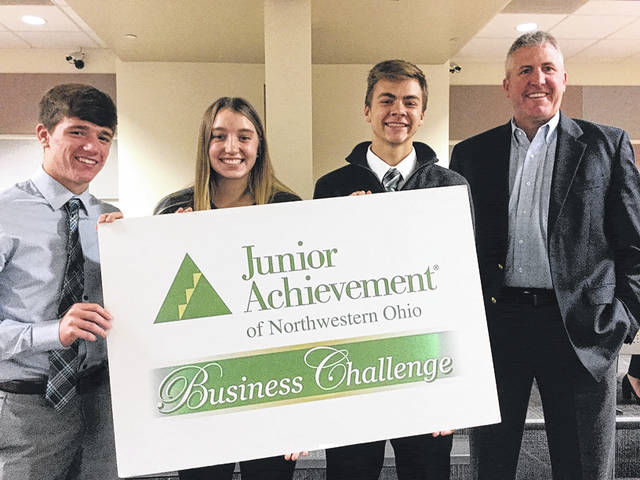 Pictured at the Business Challenge are, from left, Trevor Schaller, Sidney Taylor, Tanner Callicotte, and Mike Sietz of Owens Corning.