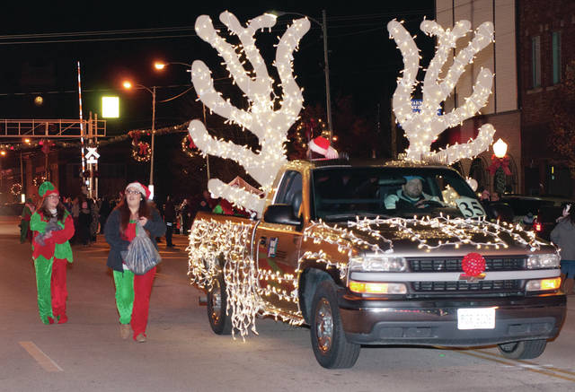 A truck from Wauseon Machine and Manufacturing is decked out to look like a famous reindeer during last year's parade.