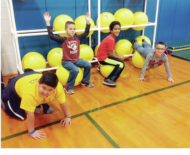 "Fourth grade students at Archbold Elementary School participate in ""Crunch Out Obesity."""
