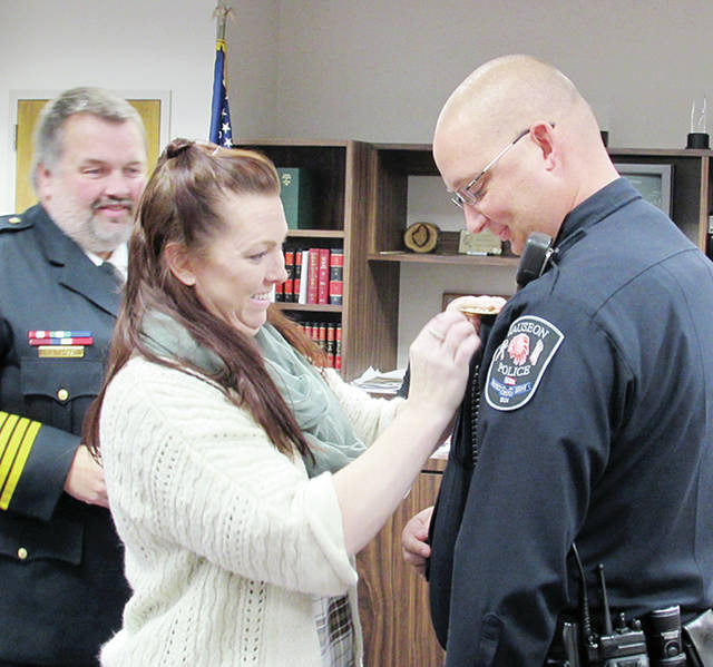 Wauseon Patrolman Will Rogers received the rank of sergeant during a swearing-in ceremony at Monday's City Council meeting. Rogers' wifepinned him with the designation as Chief Keith Torbet looked on.