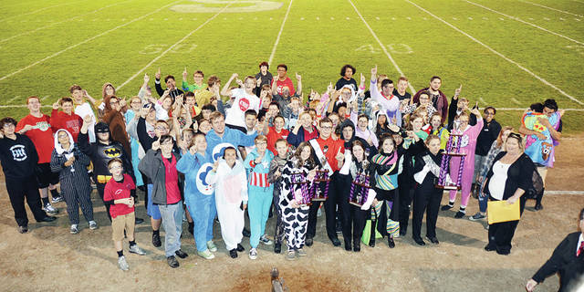 """The Wauseon Marching Band won big at the Swanton Bulldog Bowl on Oct. 21, placing first in Class B, Best Overall Visual, Best Overall General Effect, and Grand Champion. The band also received a Superior rating, qualifying it for the state competition for the 20th consecutive year. The Marching Indians performed their 2017 competition show """"Bach, Beethoven, and the Boys – The 'Classical Mystery Tour.'"""" They were welcomed back to Wauseon with an escort courtesy of the Wauseon Police Department. They will compete at the state competition Sunday, Nov. 5, at 5:15 p.m., in Dayton at the Welcome Stadium. The 2017 Wauseon Marching Indians are under the field direction of Paige Moden and Sophia Stockham, and guided by Don Clark, director of bands; Amanda Aniolowski, assistant director of bands; Dr. Mark Cook, director of percussion; Jamie Clark, Color Guard director; and Austin Brown, visual coordinator."""