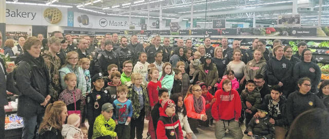Area law enforcement and fire departments brought Christmas cheer to 42 Fulton County children on Saturday. At Christmas for Kids in Fulton County, children were able to shop for themselves at Walmart in Wauseon thanks to numerous generous donations. The day started with breakfast at the Wauseon Fire Department and then the kids were taken on a lights and siren trip to Walmart.