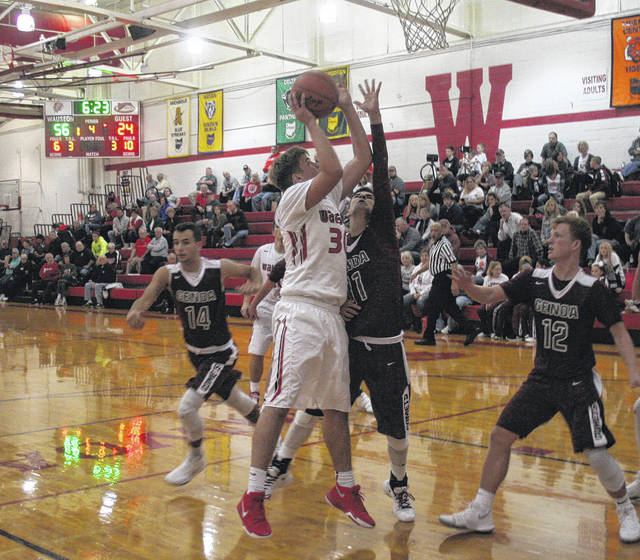 Sean Brock of Wauseon scores inside during the fourth quarter of Tuesday's non-league contest versus Genoa. The Indians bested the Comets, 66-38.