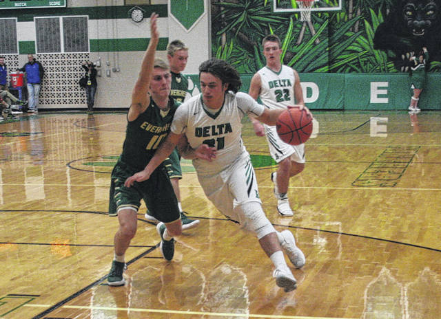 Bowen Green of Delta, right, heads to the hoop in a non-league game against Evergreen Friday. The Panthers rebounded from an early deficit to defeat the Vikings 51-45.