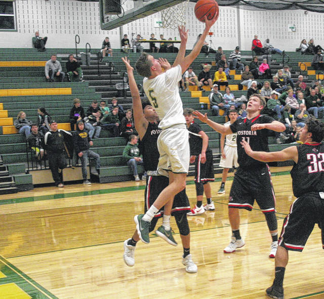 Bryce Hudik of Evergreen gets a reverse layup Thursday against Fostoria in the semifinal of the Northwest Ohio Holiday Classic at Evergreen. He led all scorers with 17 points.