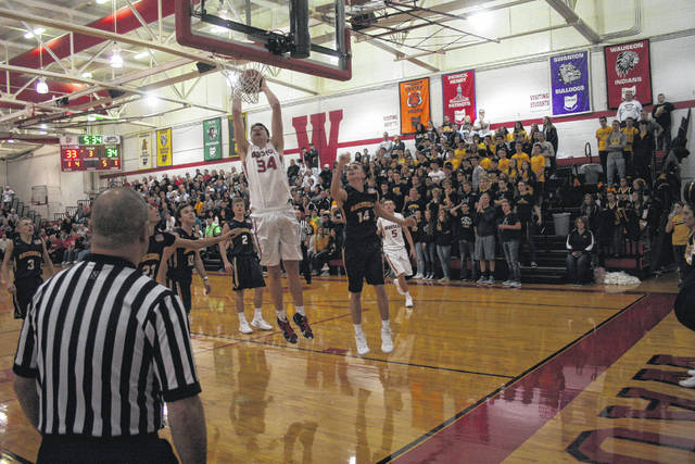 Austin Rotroff of Wauseon throws down a dunk in the second half Saturday against Archbold in the season opener. The Indians held off the Blue Streaks, 60-54.