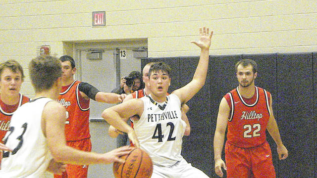 Graeme Jacoby of Pettisville (42) calls for the ball in the low block Tuesday against Hilltop. The Blackbirds defeated the Cadets 79-36.