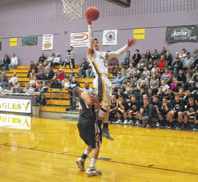 Fayette's Trey Keefer with a layup off a steal Thursday against North Central in Buckeye Border Conference action. He paced the Eagles with 14 points as they downed North Central 62-15.