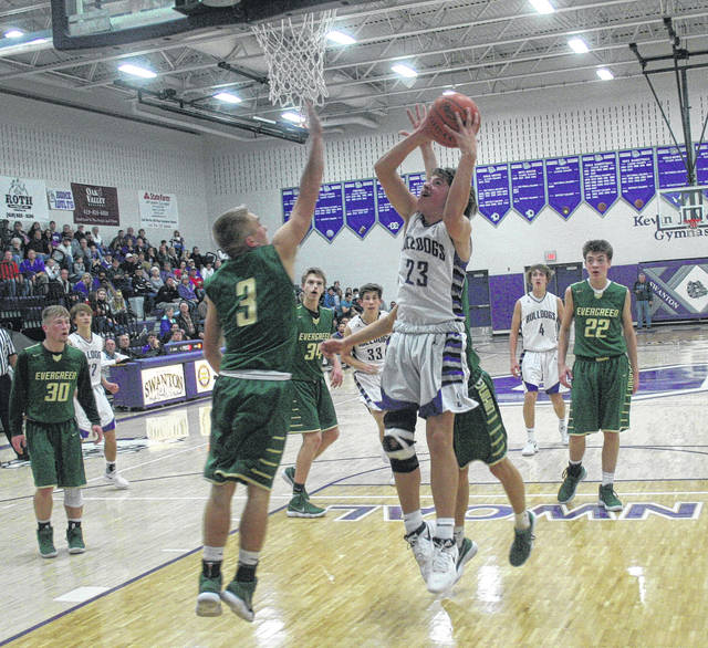 Andrew Thornton of Swanton with a bucket and also adds the free throw for a three-point play Friday against Evergreen. The Bulldogs defeated the Vikings 40-39.