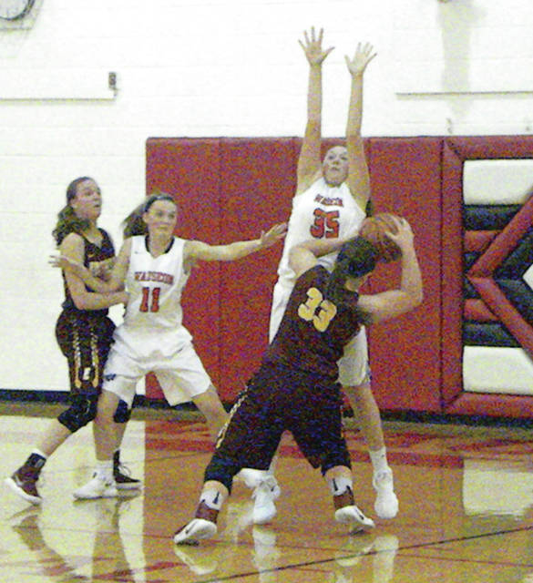 Sydney Zirkle of Wauseon (35) defends the hoop Monday night against Edgerton. The Indians got their first win of the season, 46-41, over the Bulldogs.