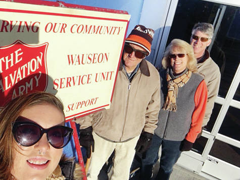 Members of Jim and Hazel Figy's family kicked off the Salvation Army bell-ringing season by covering all shifts at the Wauseon Walmart on Black Friday. This is the third year the Figy family has covered all shifts on the day after Thanksgiving. Pictured, from left, are Hannah Figy of Indiana, Jim Figy of Wauseon, and Marsha Figy Stenstrom and Michael Stenstrom of Maine.