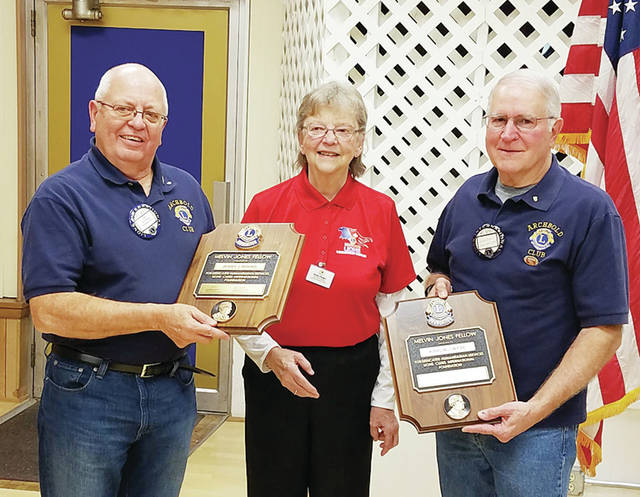 Two longtime Archbold Lions Club members were recently named Melvin Jones Fellows. Jerry Rohrs and Karlin Wyse received a plaque from the Lions Club International Foundation from former District 13-1 Governor and current Lions Club International Foundation Coordinator Barbara Plaugher. The Fellow is based on clubs' donations to humanitarian needs in communities around the world. Rohrs and Wyse have been active members of the Archbold Lions Club for 45 years, and were nominated by the club because of their many community efforts.
