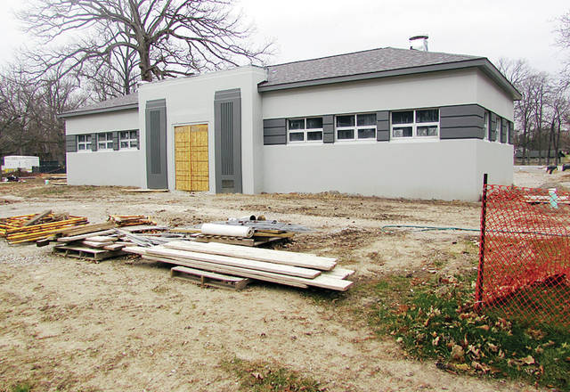 Renovations are evident on the former bath house of the Wauseon community pool. Except for some masonry recently completed, work on the city's new $1.4 million pool complex will halt for the winter.