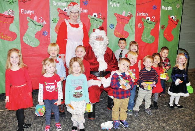 Four County Career Center's Preschool/Childcare Center students presented their annual Christmas program for parents and grandparents. The Early Childhood Education students work with the children as part of their lab experience. Shown during the program with Santa Claus and Mrs. Claus are - front, from left - Sylvie Zartman of Antwerp, Audrey Brywczynski of Whitehouse, Elowyn Custer of Wauseon, Brennan Vandock of Delta, Zachary Norden of Napoleon, Micah Helberg of Napoleon, Giuliana Zetter of Toledo, Isabella Schoonover of Defiance - back, from left - Malcolm Custer of Wauseon, Jordan Inkrott of Delta, Santa Claus, Stryker Oyer of Napoleon, Jayden Elmer of Helena, and Zane Reed of Napoleon. Mrs. Claus is standing in back. The preschool is run under the direction of Early Childhood Education instructor Susan Myers, along with preschool staff person Katelyn Flanary and education aide Jennifer Hutchison.