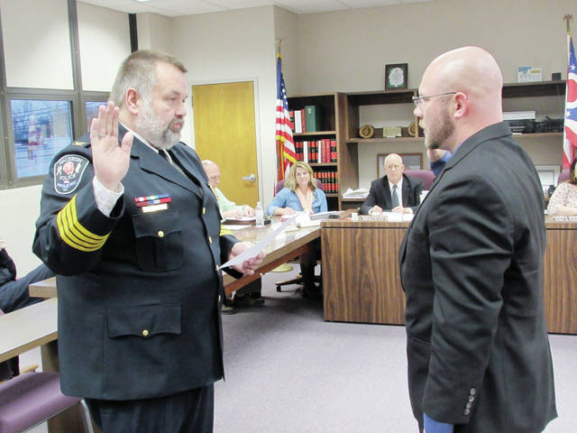 Wauseon Police Chief Keith Torbet administered the oath of office to Joe Bandeen, a new patrol officer, at Monday's City Council meeting.