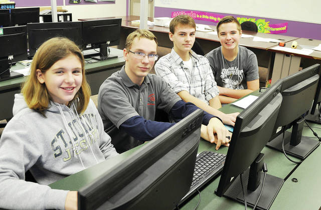 """Evergreen Middle School eighth graders participated in """"Exploring Careers Hands On for 8th Graders"""" (ECHO) held at Four County Career Center in Archbold. Career Explorers from FCCC guided the students through several careers that were of interest to them as they look forward to planning for their future. Shown with Evergreen eighth graders, from left, Callie Benner, Kaden Sanford, and Logan Nidek is Career Explorer from Evergreen in the Computer Design/3D Modeling lab, second from left, Andrew Louy. ECHO for 8th Graders is made available to all eighth graders in the four county area."""