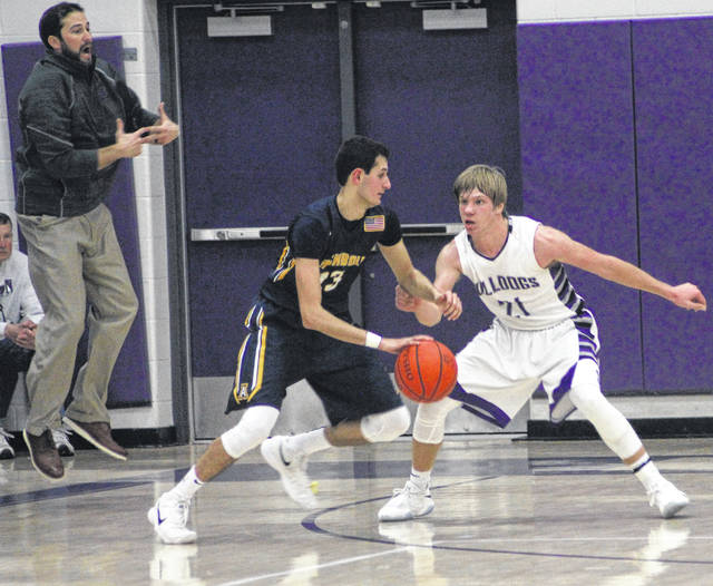 Archbold's Rigo Ramos tries to make a move around Randy Slink of Swanton on Thursday.